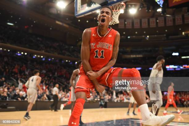 Tariq Owens of the St John's Red Storm celebrates a shot during the first round of the Big East Men's Basketball Tournament against the Georgetown...