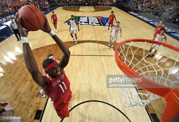 Tariq Owens of the Texas Tech Red Raiders attempts a dunk against the Virginia Cavaliers during the first half of the 2019 NCAA men's Final Four...