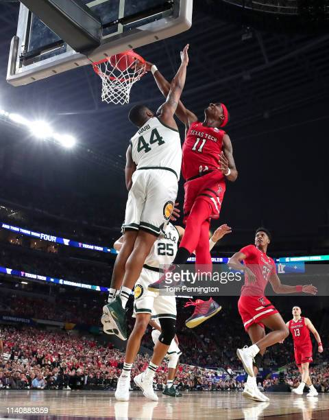 Tariq Owens of the Texas Tech Red Raiders attempts to dunk the ball against Nick Ward of the Michigan State Spartans in the first half during the...