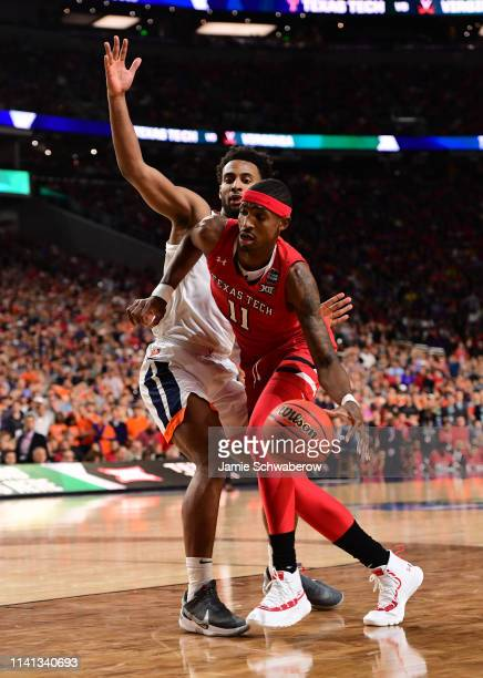 Tariq Owens of the Texas Tech Red Raiders drives against Braxton Key of the Virginia Cavaliers during the first half in the 2019 NCAA men's Final...