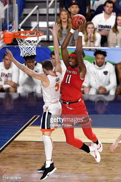 Tariq Owens of the Texas Tech Red Raiders dunks the ball against Kyle Guy of the Virginia Cavaliers in the first half during the 2019 NCAA men's...