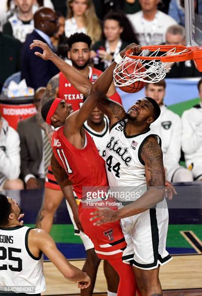 Tariq Owens of the Texas Tech Red Raiders dunks the ball against Nick Ward of the Michigan State Spartans in the first half during the 2019 NCAA...