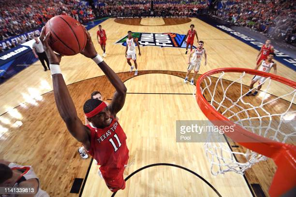 Tariq Owens of the Texas Tech Red Raiders dunks the ball against the Virginia Cavaliers during the 2019 NCAA men's Final Four National Championship...