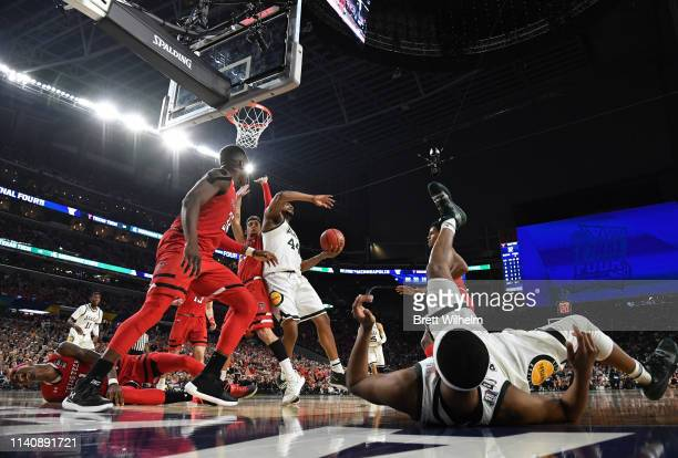 Tariq Owens of the Texas Tech Red Raiders falls on court during the second half of the semifinal game in the NCAA Photos via Getty Images Men's Final...