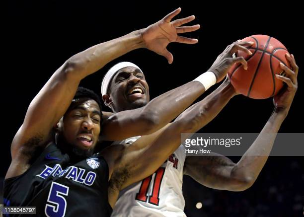 Tariq Owens of the Texas Tech Red Raiders grabs the rebound away from CJ Massinburg of the Buffalo Bulls during the second half of the second round...