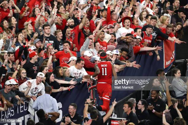 Tariq Owens of the Texas Tech Red Raiders returns to the game after an injury during the second half of the semifinal game in the NCAA Photos via...