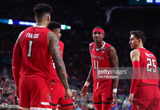 Tariq Owens of the Texas Tech Red Raiders speaks with his teammates against the Virginia Cavaliers in the first half during the 2019 NCAA men's Final...