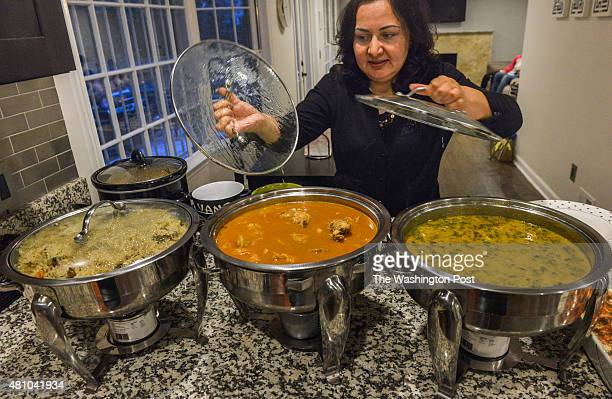 Tariq Rehman and his wife Sonia host a small Iftar to break fast for Ramadan in their home on July 2015 in Fairfax VA Pictured Sonia uncovers the...