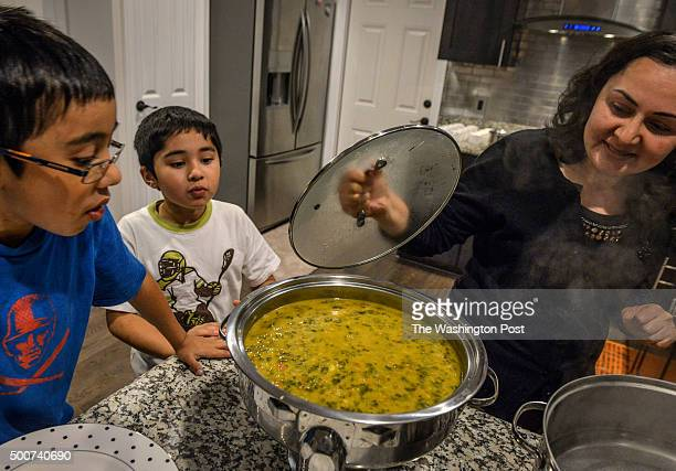 Tariq Rehman and his wife Sonia host a small Iftar to break fast for Ramadan in their home on July 2015 in Fairfax VA Pictured Sonia right checks on...