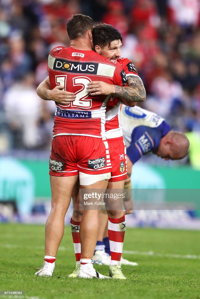 Tariq Sims and Gareth Widdop of the Dragons celebrate victory during the round 14 NRL match between the Canterbury Bulldogs and the St George Illawarra Dragons at ANZ Stadium on June 11, 2018 in Sydney, Australia.