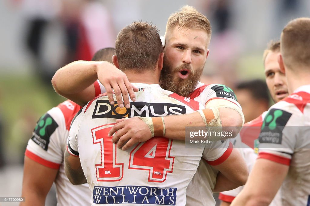 Tariq Sims and Jack de Belin of the Dragons celebrate victory during the round one NRL match between the St George Illawarra Dragons and the Penrith Panthers at UOW Jubilee Oval on March 4, 2017 in Sydney, Australia.