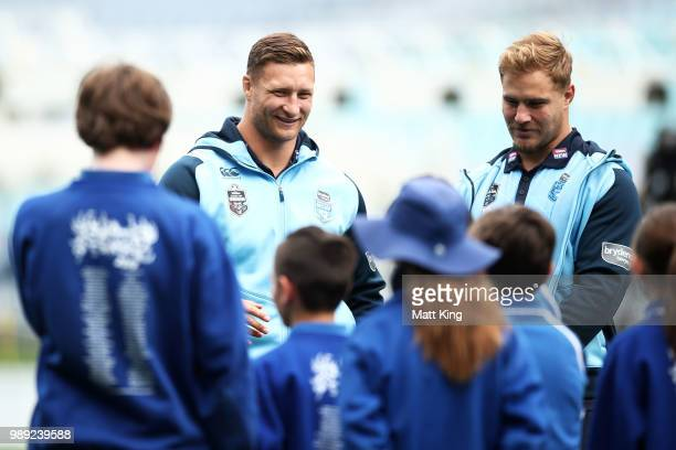 Tariq Sims and Jack de Belin take part in a juniors coaching clinic during the New South Wales Blues State of Origin Team Announcement at ANZ Stadium...