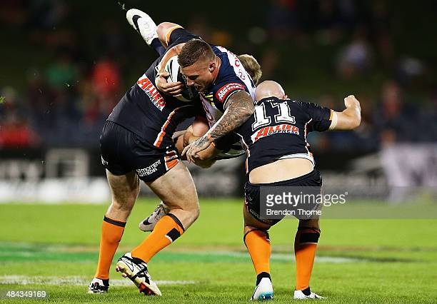 Tariq Sims of the Cowboys is tackled by the Tigers defence during the round 6 NRL match between the Wests Tigers and the North Queensland Cowboys at...