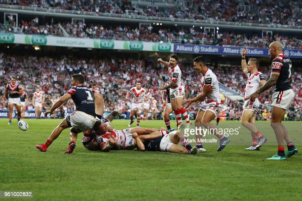 Tariq Sims of the Dragons celebrates scoring a try during the round eight NRL match between the St George Illawara Dragons and Sydney Roosters at...