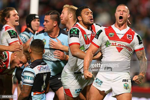 Tariq Sims of the Dragons celebrates with teammates after scoring a try during the round 23 NRL match between the St George Illawarra Dragons and the...
