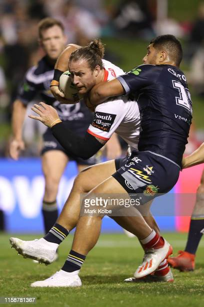 Tariq Sims of the Dragons is tackled during the round 15 NRL match between the St George Illawarra Dragons and the North Queensland Cowboys at WIN...