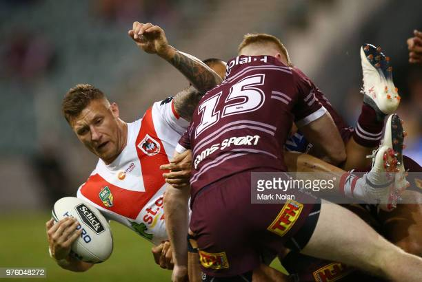 Tariq Sims of the Dragons is tackled during the round 15 NRL match between the St George Illawarra Dragons and the Manly Sea Eagles at WIN Stadium on...
