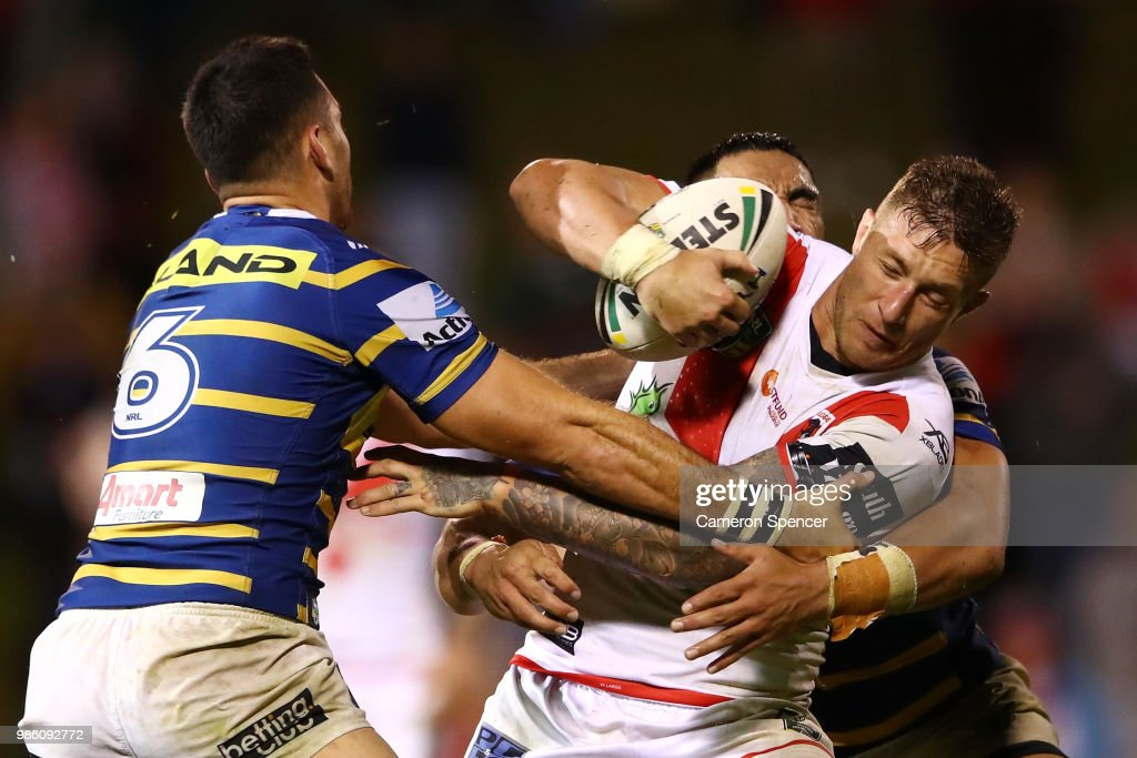 Tariq Sims of the Dragons is tackled during the round 16 NRL match between the St George Illawarra Dragons and the Parramatta Eels at WIN Stadium on June 28, 2018 in Wollongong, Australia.