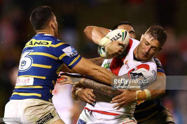 Tariq Sims of the Dragons is tackled during the round 16 NRL match between the St George Illawarra Dragons and the Parramatta Eels at WIN Stadium on...