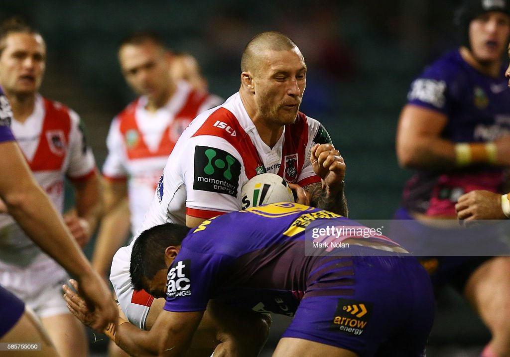 Tariq Sims of the Dragons is tackled during the round 22 NRL match between the St George Illawarra Dragons and the Brisbane Bronocs at WIN Stadium on August 4, 2016 in Wollongong, Australia.