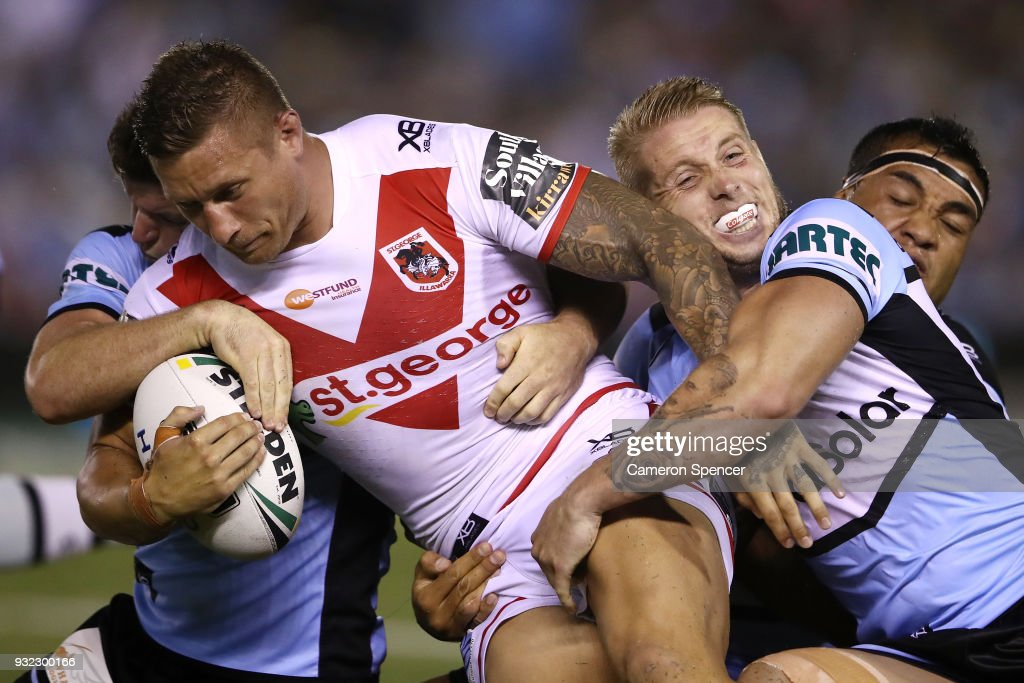 Tariq Sims of the Dragons is tackled during the round two NRL match between the Cronulla Sharks and the St George Illawarra Dragons at Southern Cross Group Stadium on March 15, 2018 in Sydney, Australia.