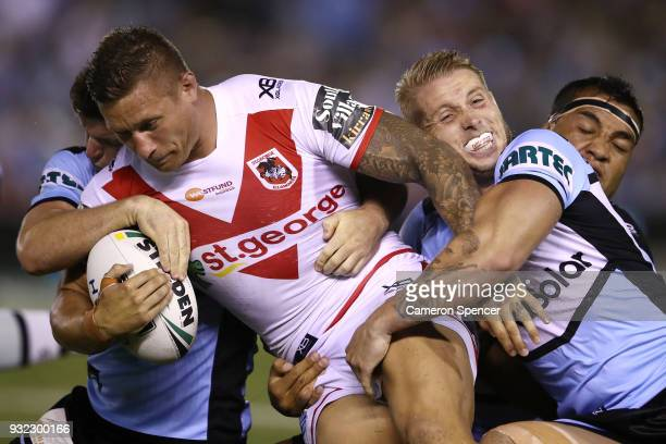Tariq Sims of the Dragons is tackled during the round two NRL match between the Cronulla Sharks and the St George Illawarra Dragons at Southern Cross...