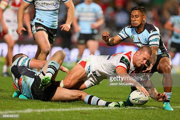 Tariq Sims of the Dragons scores a try during the round 23 NRL match between the St George Illawarra Dragons and the Cronulla Sharks at WIN Jubilee...