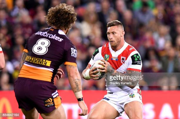 Tariq Sims of the Dragons takes on the defence of Korbin Sims of the Broncos during the round 24 NRL match between the Brisbane Broncos and the St...