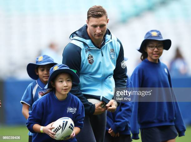 Tariq Sims takes part in a juniors coaching clinic during the New South Wales Blues State of Origin Team Announcement at ANZ Stadium on July 2 2018...