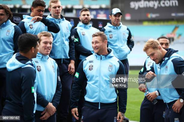 Tariq Sims talks to team mates during the New South Wales Blues State of Origin Team Announcement at ANZ Stadium on July 2 2018 in Sydney Australia