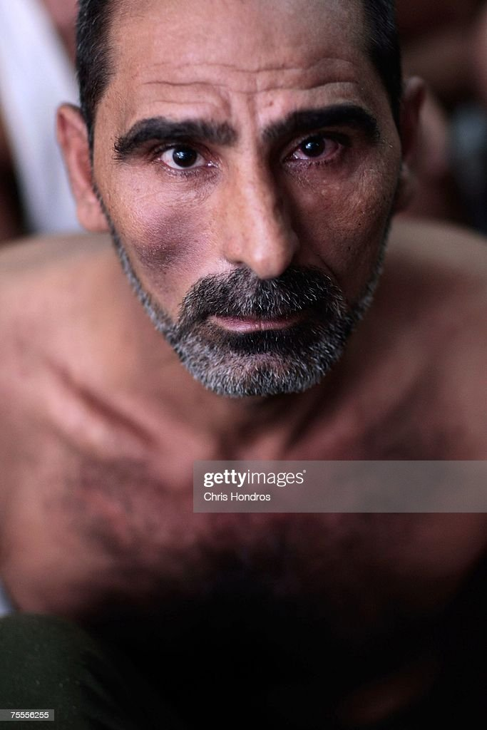 Tariq Talib Inad, 47, picked up by the Army in western Baghdad along with his son and brother, is seen at an Iraqi detention center July 19, 2007 in Baghdad, Iraq. The Iraqi detention facility at Forward Operating Base Justice in west Baghdad holds nearly a thousand men in an area designed for 300, from insurgents who have killed dozens to some who were likely simply swept up in raids and were in the wrong place at the wrong time .