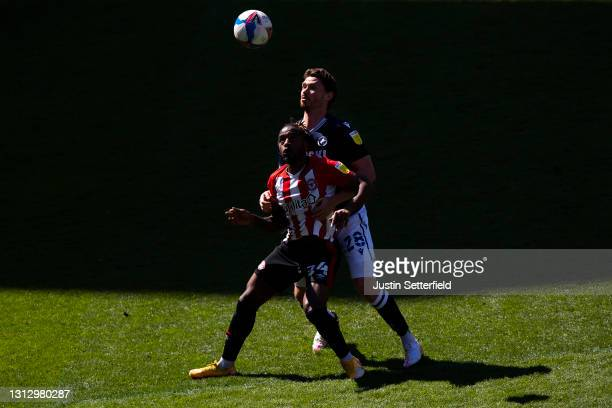 Tariqe Fosu of Brentford battles for possession with George Evans of Millwall FC during the Sky Bet Championship match between Brentford and Millwall...