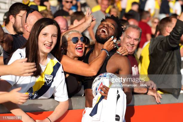 Tariqe Fosu of Oxford United celebrates his hat trick at full time with the Oxford united fans at the Sky Bet Leauge One match between Lincoln City...