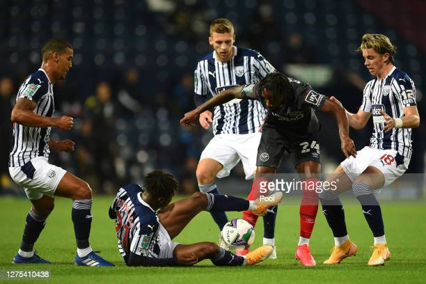 Tariqe Fosu-Henry of Brentford FC is challenged by Kyle Edwards of West Bromwich Albion during the Carabao Cup Third Round match between West...