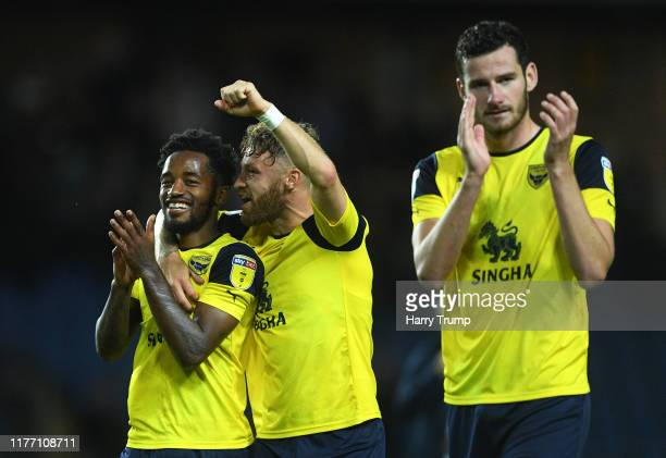 Tarique Fosu and Matty Taylor of Oxford United celebrate at the final whistle during the Carabao Cup Third Round match between Oxford United and West...