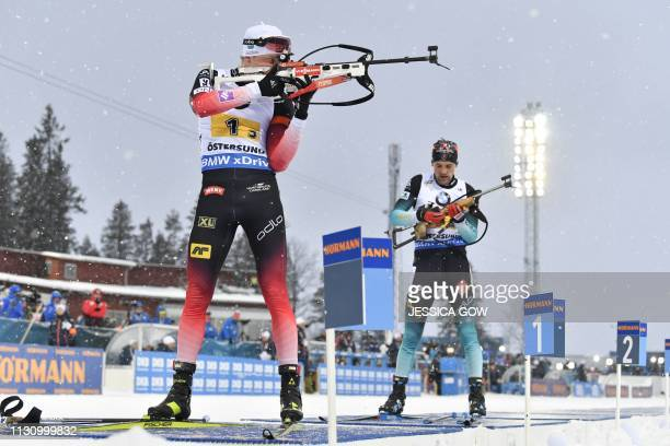Tarjei Boe of Norway and Simon Desthieux of France compete in the men's 4x75 km relay event at the IBU World Biathlon Championships in Oestersund...