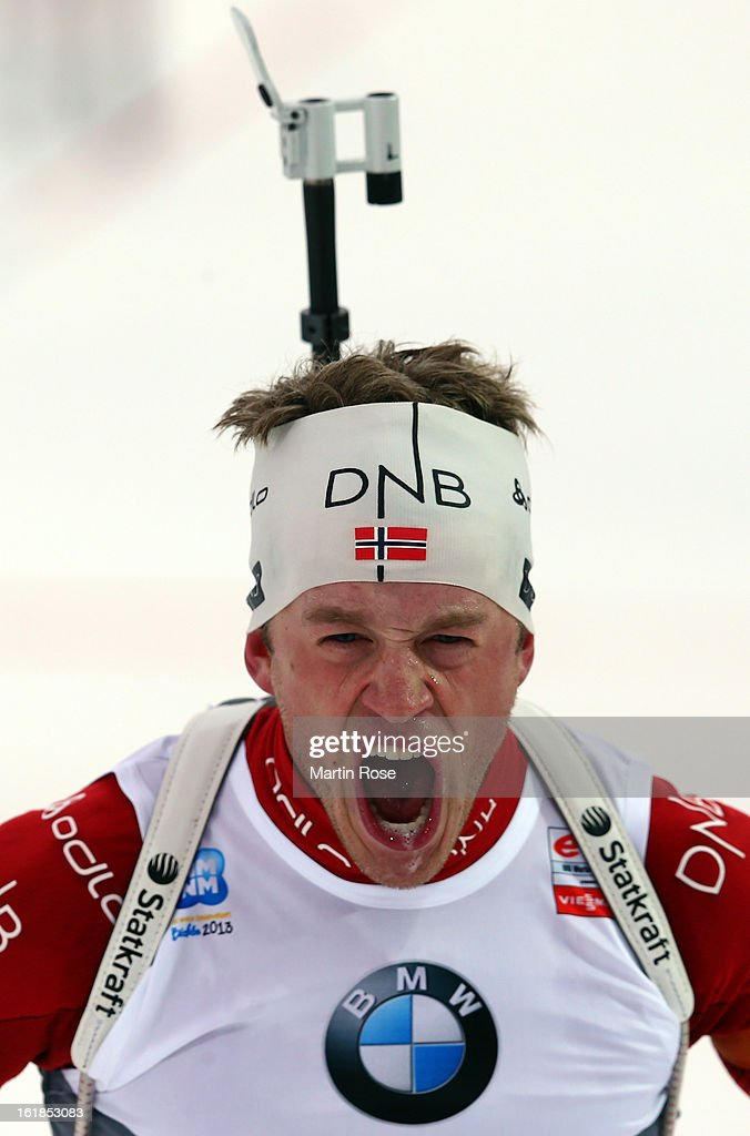 Tarjei Boe of Norway celebrates after he crosses the finish line and wins the gold medal in the Men's 15km Mass Start during the IBU Biathlon on February 17, 2013 in Nove Mesto na Morave, Czech Republic.