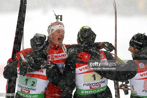 Tarjei Boe of Norway celebrates victory with his team mates Ole Einar Bjoerndalen , Emil Hegle Svendsen and Alexander Os after the men 4 x 6 km relay...