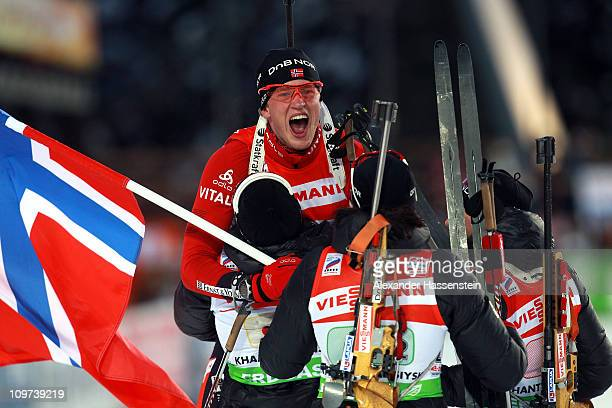 Tarjei Boe of Norway celebrates winning the gold medal at the mixed relay with his team mates Ann Kristin Aafeldt Ole Einar Bjoerndalen and Tora...