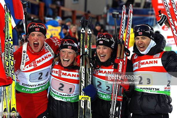 Tarjei Boe of Norway celebrates winning the gold medal at the mixed relay with his team mates Tora Berger Ann Kristin Aafeldt and Ole Einar...