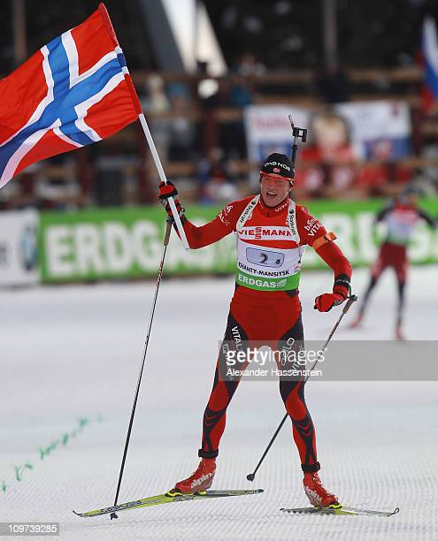 Tarjei Boe of Norway celebrates winning the gold medal at the mixed relay at the finish area during the IBU Biathlon World Championships at AV...