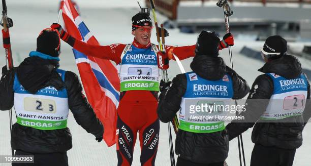 Tarjei Boe of Norway celebrates winning the gold medal with his team mates Emil Hegle Svendsen Alexander Os and Ole Einar Bjoerndalen at the finish...