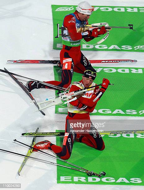 Tarjei Boe of Norway competes with his team mate Emil Hegle Svendsen during the men's mass start during the IBU Biathlon World Championships at AV...