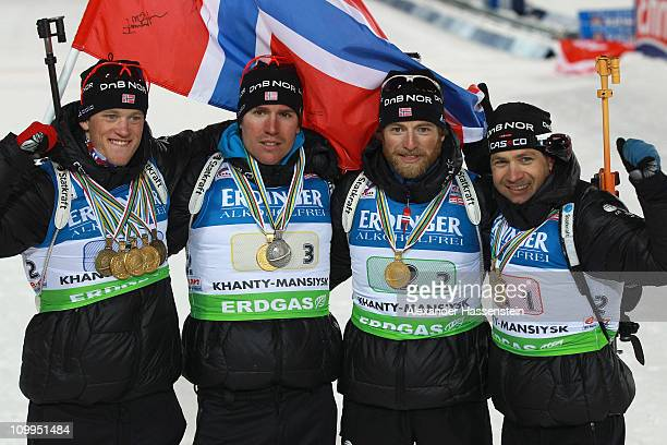 Tarjei Boe of Norway poses with his team mates Emil Hegle Svendsen Alexander Os and Ole Einar Bjoerndalen after the medal ceremony for the men's...
