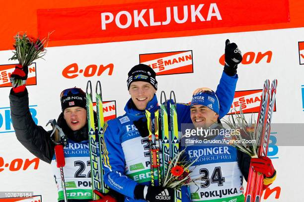 Tarjei Boe of Norway takes 2nd place Bjorn Ferry of Sweden takes 1st place and Michael Greis of Germany takes 3rd place during the IBU World Cup...