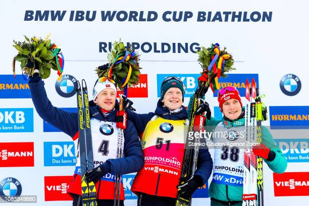 Tarjei Boe of Norway takes 2nd place, Johannes Thingnes Boe of Norway takes 1st place, Benedikt Doll of Germany takes 3rd place during the IBU...