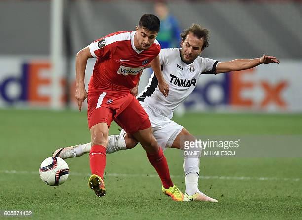 Tarkan Serbest of FK Austria Wien vies for the ball with Filipe Teixeira of FC Astra Giurgiu during the UEFA Europa League Group E football match FC...