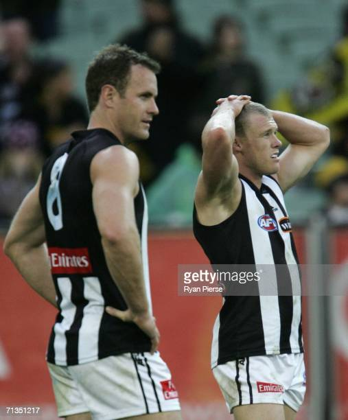 Tarkyn Lockyer and James Clement of the Magpies look dejected after the round thirteen AFL match between the Richmond Tigers and the Collingwood...