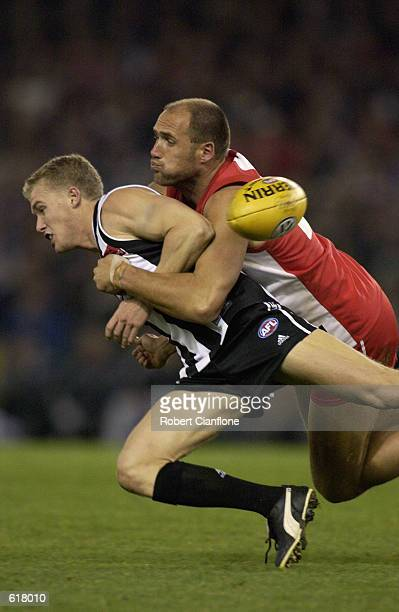 Tarkyn Lockyer of the Magpies is tackled by Tony Lockett of the Swans during the round 10 AFL match between the Collingwood Magpies and the Sydney...