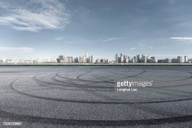 tarmac roads and modern city skylines - china east asia stock pictures, royalty-free photos & images